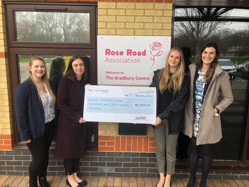 Irwin Mitchell staff hand over giant cheque